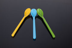 Different colors of the spoon. The children to use plastic spoon, a variety of bright colors, popular children's favorite, suitable for use by children Stock Photo