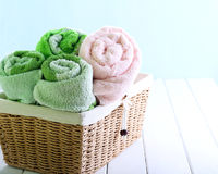 Different colors towels  in wicker basket Stock Photo
