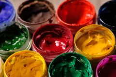 Different colour paint in bottles closeup Stock Photo