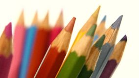 Different colour pencils isolated on white stock video