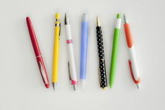 Different colour, type, pen and pencil on white background stock image