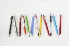 Different colour, type, pen and pencil on white background royalty free stock photos