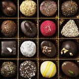 Different coloured chocolates, square photos and geometric lines royalty free stock photo