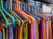 Different coloured sarees on hangar for sale stock images