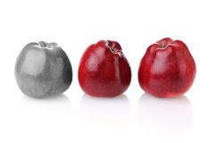 Different colourless apple with two red ones. Different colourless apple with three fresh red apples on white background Royalty Free Stock Images