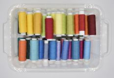 Sewing threads in the box on the background royalty free stock photo