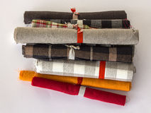 Different colours rolls of linen cloth. Small rolls of linen cloth . Various linen fabric textile rolls Stock Photos