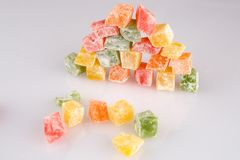 Different colours Turkish delight on white background.  stock photos