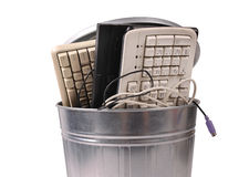 Different computer parts in trash can. Different computer parts and phone in trash can Stock Image
