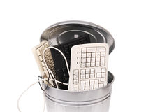 Different computer parts in trash can. Different computer parts and phone in trash can Stock Photo