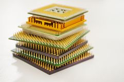 Different computer processors on a white background. Stacked in a stack stock images