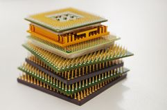 Different computer processors on a white background. Stacked in a stack royalty free stock images