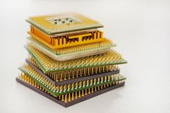 Different computer processors on a white background. Stacked in a stack royalty free stock photo
