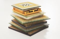 Different computer processors on a white background. Stacked in a stack stock photography