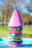 Different cone color birthday party hats. Fun party hats with an elastic string to keep hat in place without falling off easily stock photography