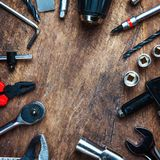 Different construction tools with Hand tools for home renovation. On wooden board maintenance and reparing concept Royalty Free Stock Photo