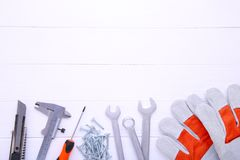 Different construction tools on white wooden background with copy space royalty free stock images