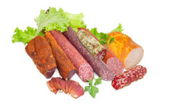 Different cooked meat products with greens on a light background Royalty Free Stock Photo