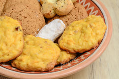Different cookies in a clay plate Royalty Free Stock Photo