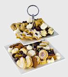 Different cookies on an etagere Royalty Free Stock Images