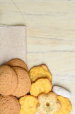 Different cookies on a wooden table Stock Photo