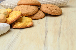 Different cookies on a wooden table Stock Photography