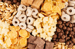Different corn flakes top view, cereals background. Royalty Free Stock Image