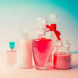 Different cosmetic bottles and products set . Cosmetic package collection for cream, soaps, foams, shampoo and perfume on Beautifu Royalty Free Stock Photos