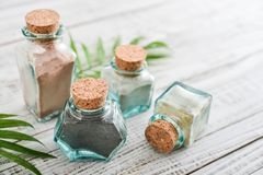 Different cosmetic clay. In vintage jars on wooden background Stock Image