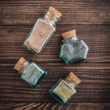 Different cosmetic clay. In vintage jars on wooden background, top view Stock Photography