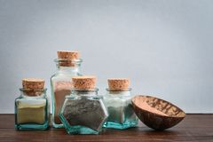 Different cosmetic clay in vintage jars. On blue background Royalty Free Stock Images