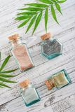Different cosmetic clay. In vintage jars on wooden background, top view Royalty Free Stock Image