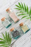 Different cosmetic clay. In vintage jars on wooden background, top view Stock Photos