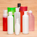 Different cosmetic products on wooden surface Royalty Free Stock Photo