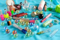 Different cosmetics scattered Royalty Free Stock Photo