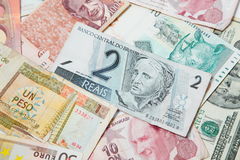 Different countries. Brazilian real in the middle. Background from paper money of the different countries. Brazilian real in the middle Stock Photography