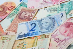 Different countries. Brazilian real in the middle. Background from paper money of the different countries. Brazilian real in the middle Stock Photo