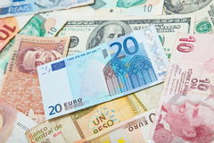 Different countries. European euro in the middle. Background from paper money of the different countries. European euro in the middle Royalty Free Stock Photography