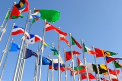 Different countries flags. United together against blue sky Royalty Free Stock Photography