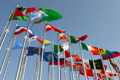 Different countries flags. United together against blue sky Stock Photography