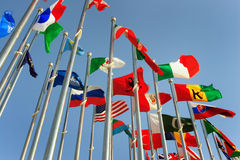 Different countries flags. United together against blue sky Royalty Free Stock Photos