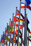 Different countries flags against blue sky. D Royalty Free Stock Images