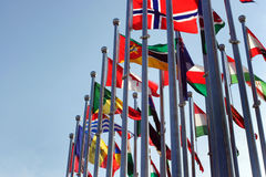 Different countries flags against blue sky. Different countries flags united together against blue sky Royalty Free Stock Photography