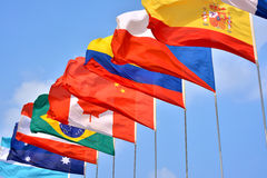 Different countries flags. Different countries national flags getting together under blue sky, shown as worldwide, country, and international communication or Royalty Free Stock Images