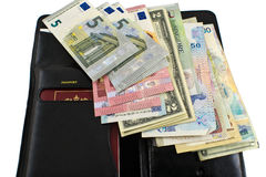 Different countries money and wallet on white background. Photo of the purse and laid out money in different countries Stock Image