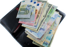 Different countries money and wallet on white background. Photo of the purse and laid out money in different countries Stock Images