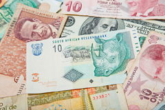 Different countries. South african Rand in the middle. Background from paper money of the different countries. South african Rand in the middle Royalty Free Stock Photos