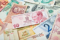 Different countries. Turkish lira in the middle. Background from paper money of the different countries. Turkish lira in the middle Stock Photography