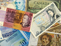 Different country banknotes. Pile of banknotes from different countries around the World Royalty Free Stock Photography