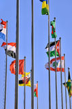 Different country flags. Different countries national flags on pole together, shown as worldwide, country, and international communication or activities Stock Images